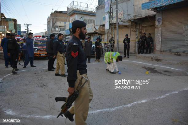 Pakistani investigators gather at the shooting site in Quetta on May 27 2018 A shootout in Pakistan's southwestern Quetta city on Sunday evening left...