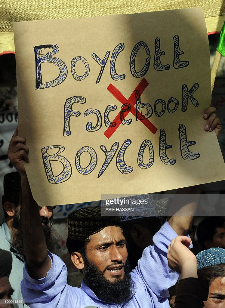 A Pakistani Islamist holds a placard during a protest in Karachi on May 20, 2010, against the published caricatures of Prophet Mohammed on Facebook. Pakistan 'strongly condemned' caricatures of the Prophet Mohammed that appeared on social networking website Facebook as insulting to Muslims worldwide. The Pakistan Telecommunications Authority (PTA) blocked access to Facebook and YouTube in a growing row sparked when a private Facebook user asked people to send in drawings of the Prophet Mohammed.