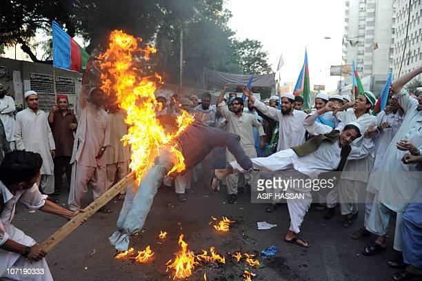 Pakistani Islamist students from Jamiat Talaba Arabia burn an effigy of Punjab governor Salman Taseer as they chant slogans against Asia Bibi a...
