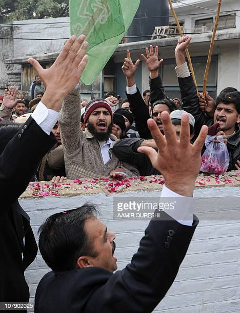 Pakistani Islamists and lawyers chant slogans in support of arrested Pakistani bodyguard Malik Mumtaz Hussain Qadri, the alleged killer of Punjab's...