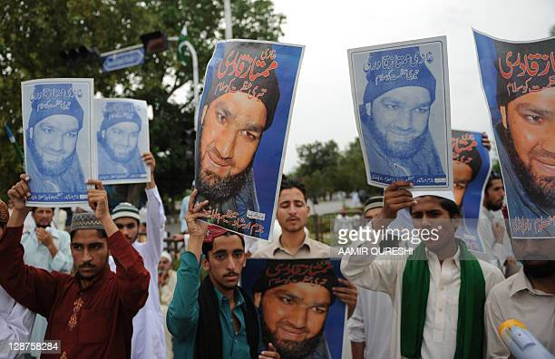 Pakistani Islamists and supporters carry portraits of convicted killer Malik Mumtaz Hussain Qadri, during a protest against a court verdict in...
