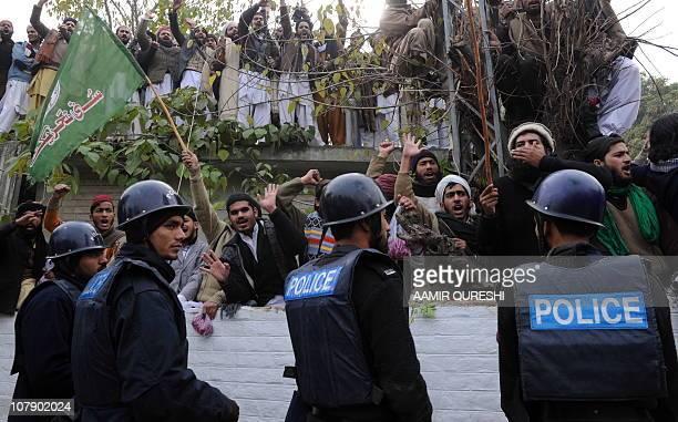 Pakistani Islamists chant slogans in support of arrested Pakistani bodyguard Malik Mumtaz Hussain Qadri the alleged killer of Punjab's governor...