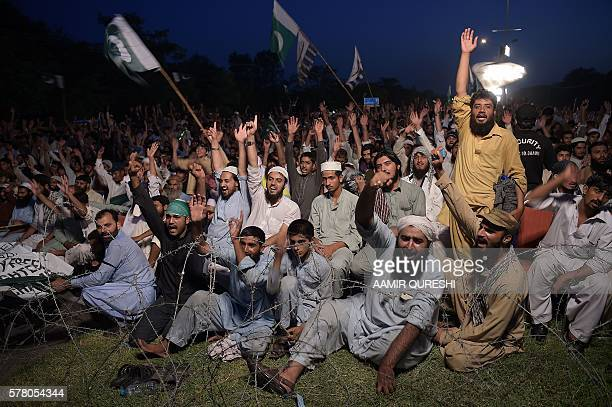 Pakistani Islamists shout antiIndian slogans at a rally to show solidarity with Indian Kashmiri Muslims as they observed a 'Black Day' to denounce...