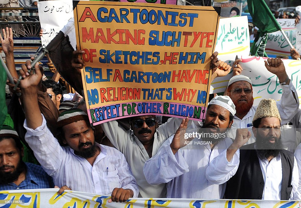 Pakistani Islamists shout slogans during a protest in Karachi on May 21, 2010, against the published caricatures of Prophet Mohammed on Facebook. Pakistani protesters shouted 'Death to Facebook', 'Death to America' and burnt US flags, venting growing anger over 'sacrilegious' caricatures of the Prophet Mohammed on the Internet. A Facebook user organised an 'Everyone Draw Mohammed Day' competition to promote 'freedom of expression', inspired by an American woman cartoonist, but sparked a major backlash in the conservative Muslim country of 170 million.