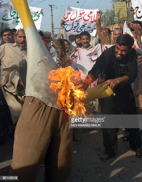 Pakistani Islamists torch an effigy of Danish Prime Minister Anders Fogh Rasmussen during a protest in Multan on March 6 against the publication of...