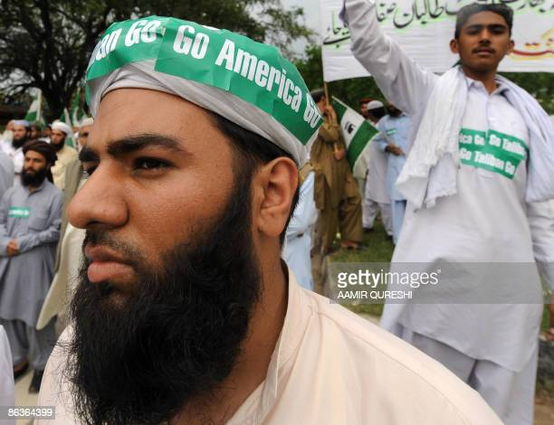 Pakistani Islamists wear slogans saying 'Go Taliban Go' and 'Go America Go' during an antiTaliban and antiUS protest rally in Islamabad on May 4 2009...