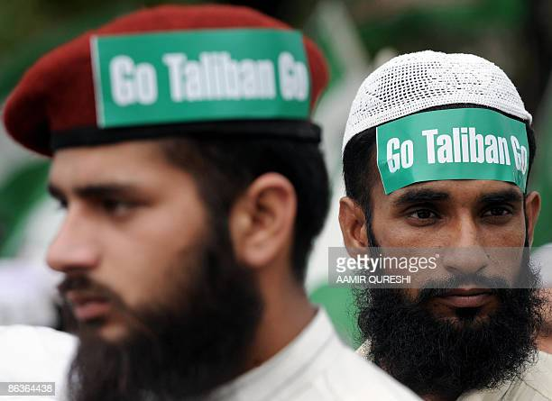 Pakistani Islamists wear slogans saying 'Go Taliban Go' during an antiTaliban and antiUS protest rally in Islamabad on May 4 2009 A peace deal in...