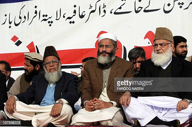 Pakistani JamaateIslami chief Syed Munawar Hassan Former JI chief Qazi Hussein Ahmed and Sirajul Haq sit during a rally in Islamabad on December 5...