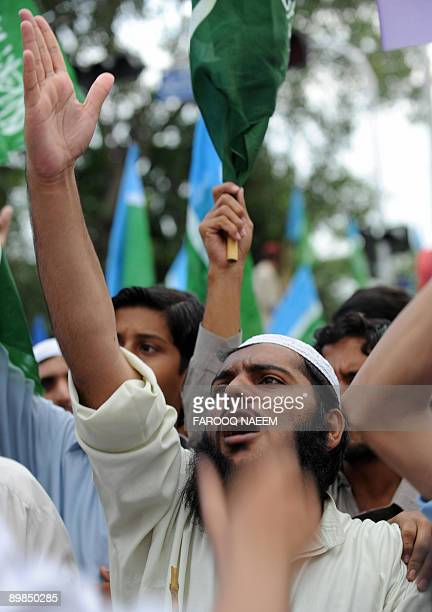 Pakistani JamaateIslami party supporters shout slogans during a march towards the US embassy in Islamabad on August 18 2009 in protest against the...