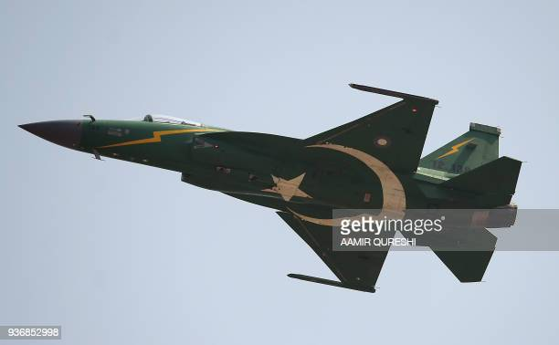 A Pakistani JF17 thunder aircraft flys during the Pakistan Day military parade in Islamabad on March 23 2018 Pakistan National Day commemorates the...