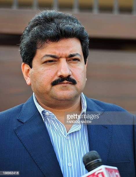 Pakistani journalist and television anchor Hamid Mir talks with media representatives outside his home in Islamabad on November 26 2012 A highprofile...