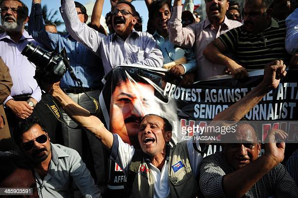 Pakistani journalist shout slogans during a protest against an attack on television anchor Hamid Mir in Karachi on April 21 2014 A leading Pakistani...