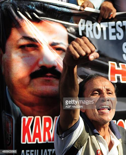 A Pakistani journalist shouts slogan during a protest against an attack on television anchor Hamid Mir in Karachi on April 21 2014 A leading...