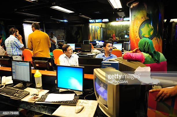 Pakistani journalists gather in the newsroom of Geo television in Karachi on June 6 2014 Pakistan took the country's most popular television channel...