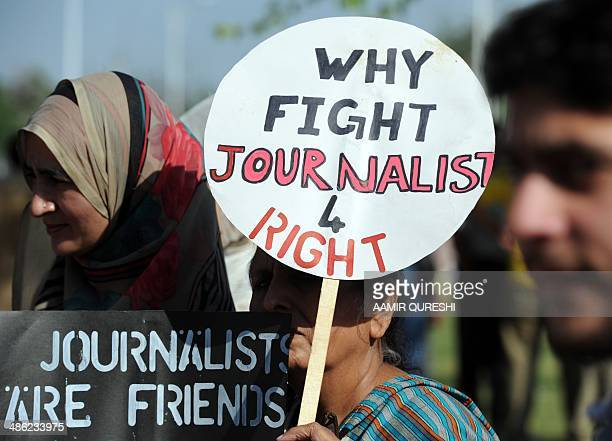 Pakistani journalists hold placards during a protest against the attack on Geo television journalist Hamid Mir by gunmen in Islamabad on April 23...