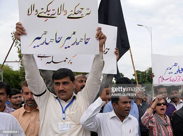 Pakistani journalists shout slogans during a protest against the attack on television journalist Hamid Mir by gunmen in Islamabad on April 21 2014 A...