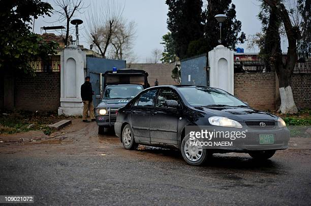 Pakistani Judge Rana Nisar Ahmad leaves with his security squad from Adiala prison in Rawalpindi on February 12 after the case hearing of...