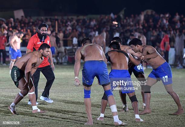 A Pakistani kabaddi player attempts to tag an Indian opponent during their final match of the 3rd Asian Kabaddi Circle Style Championship 2016 in Wah...