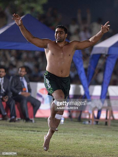 A Pakistani kabaddi player celebrates after taking a point against Indian during their final match of the 3rd Asian Kabaddi Circle Style Championship...