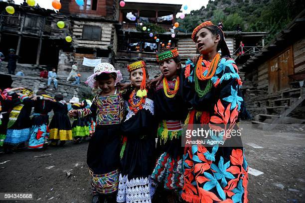 Pakistani Kalash women 'wearing traditional clothes celebrate 'Uchal' summer festival at Rumbur valley of Chitral town in Khyber Pakhtunkhwa Pakistan...
