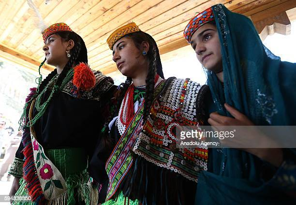 Pakistani Kalash women 'wearing traditional clothes dance as they celebrate 'Uchal' summer festival at Rumbur valley of Chitral town in Khyber...