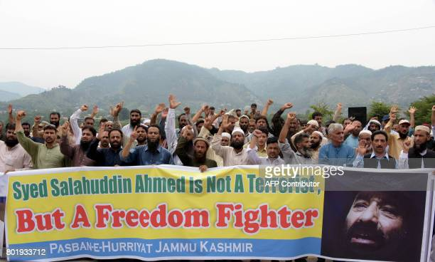 Pakistani Kashmiri activists carry a banner as they shout slogans during a protest against United States' sanctions on Syed Salahuddin supreme...