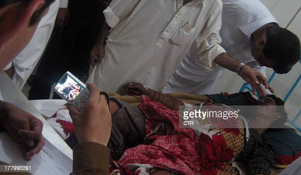 Pakistani Kashmiri relatives tend an Indian shelling victim at a hospital in Nakyal sector close to Indian border around 200 kilometres south of...