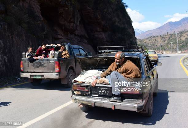 Pakistani Kashmiri residents evacuate from the border town of Chakothi in Pakistan administered Kashmir some 3km from the Line of Control on February...
