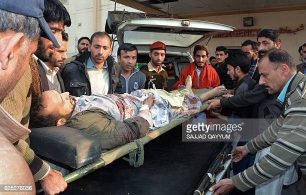 Pakistani Kashmiris shift an injured victim from the passenger bus hit in crossborder shelling at a military hospital in Muzaffarabad the capital of...