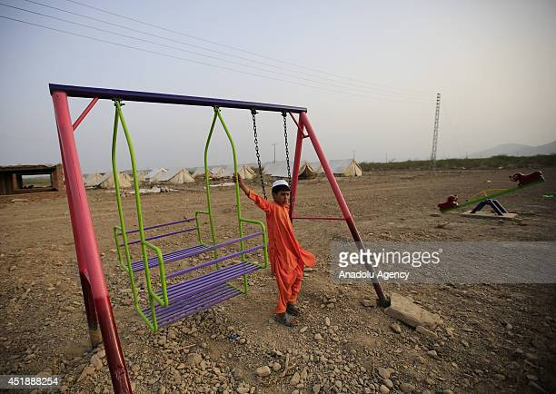 Pakistani kid fled to refugee camps due to the clashes between Pakistani army forces and Taliban militants is seen in a refugee camp built by...