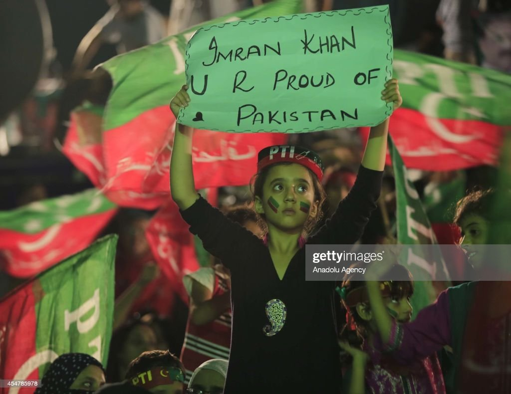 A Pakistani kid holds a placard during the speech of Pakistani