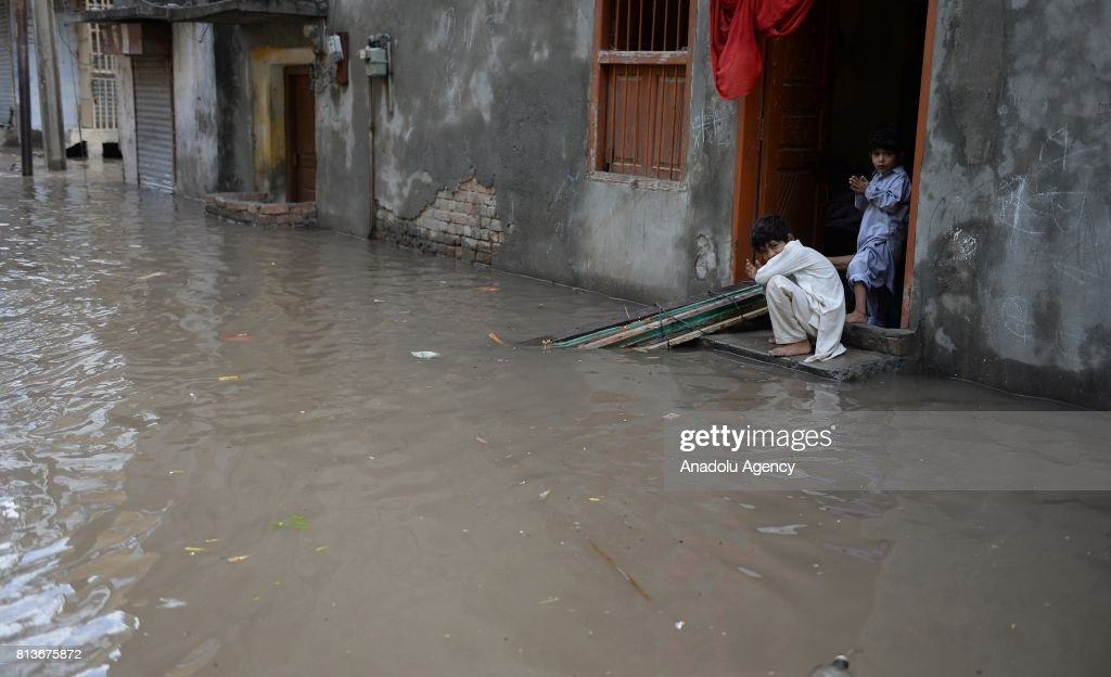 Pakistani kids are seen in front of their house during a flood after heavy monsoon rains hit Rawalpindi province of Pakistan on July 13 2017 Heavy...