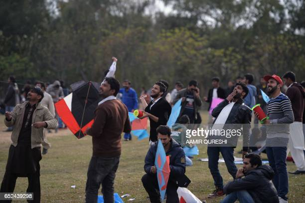 Pakistani kite flyers fly kites at a park in Islamabad on March 12 during the Basant Kite Festival which is traditionally celebrated in spring season...