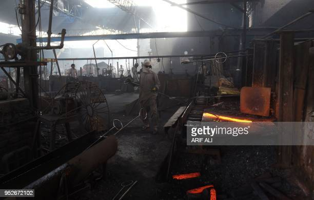 Pakistani labourer work in an iron factory in Lahore on April 28 ahead of International Workers' Day