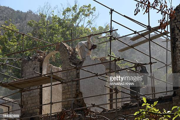 Pakistani labourers work on the rebuilding process of Pakistan's founding father QuaideAzam Muhammad Ali Jinnahs residence in Ziarat on October 11...