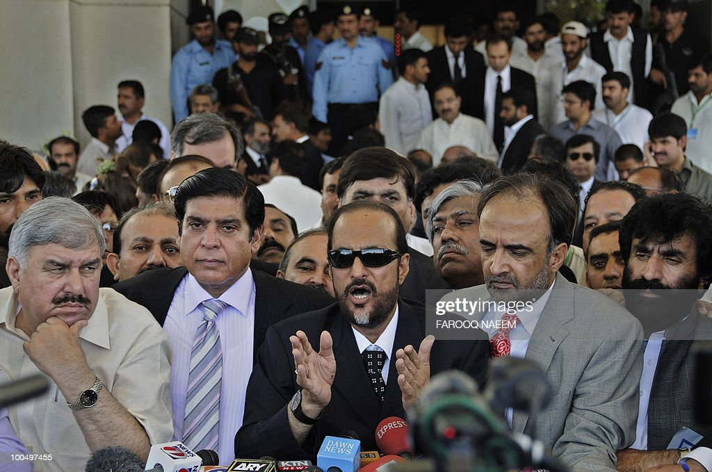 Pakistani Law Minister Babar Awan (C), flanked by Information Minister Qamar Zaman Kaira (2R) and Ayatullah Durrani, State Minister of Industries and Production (R) and Raja Pervaiz Ashraf, Minister for Water and Power (2L), Minister for Textile Industry, Rana Muhammad Farooq Saeed (L), talks to the media after appearing at the Supreme Court in Islamabad on May 25, 2010. Pakistan's Supreme Court gave the government a two-week ultimatum to submit a report on steps being taken to re-open corruption cases against the head of state and other politicians. President Asif Ali Zardari is immune from prosecution while in office, but the supreme court is piling pressure on the government to reopen and prosecute cases after it scrapped an amnesty shielding politicians last December. AFP PHOTO/Farooq NAEEM