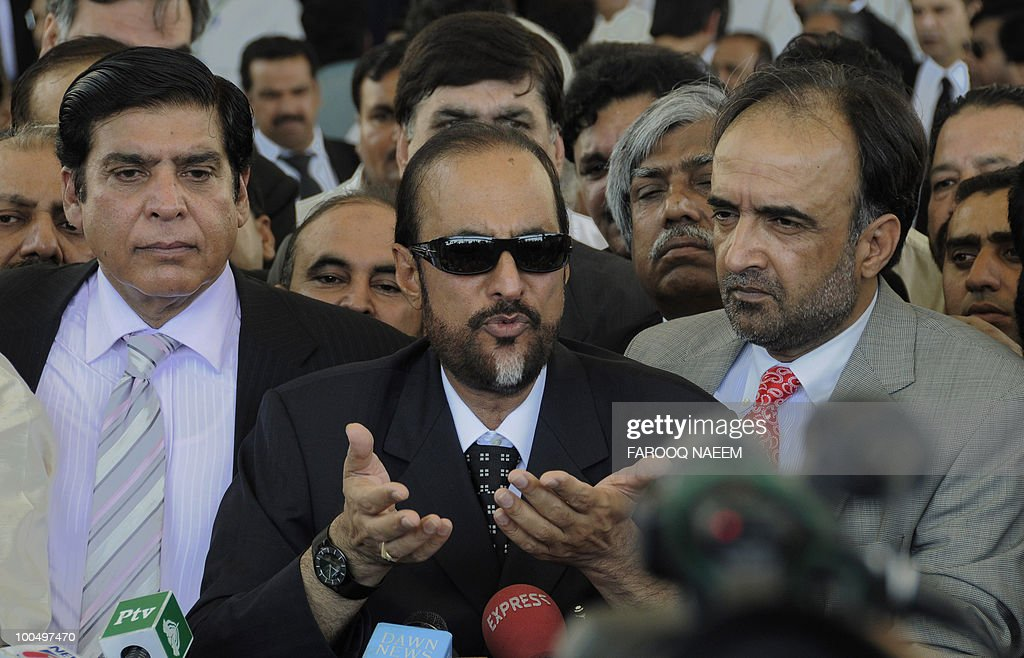 Pakistani Law Minister Babar Awan (C), flanked by Information Minister Qamar Zaman Kaira (R) and Raja Pervaiz Ashraf, Minister for Water and Power (L), talks to the media after appearing at the Supreme Court in Islamabad on May 25, 2010. Pakistan's Supreme Court gave the government a two-week ultimatum to submit a report on steps being taken to re-open corruption cases against the head of state and other politicians. President Asif Ali Zardari is immune from prosecution while in office, but the supreme court is piling pressure on the government to reopen and prosecute cases after it scrapped an amnesty shielding politicians last December. AFP PHOTO/Farooq NAEEM