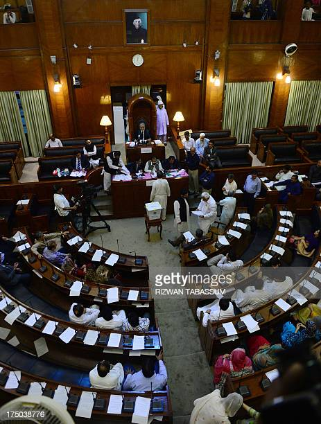 Pakistani lawmakers gather at the Sindh provincial assembly during Presidential election voting in Karachi on July 30 2013 Pakistani lawmakers on...