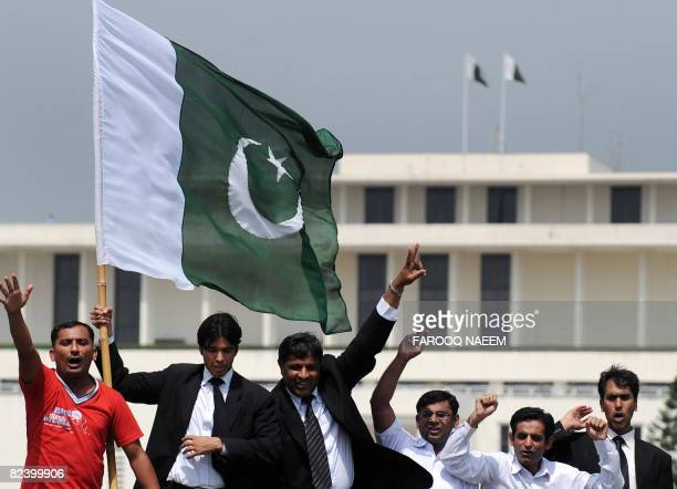 Pakistani lawyers celebrate after President Pervez Musharraf announced his resignation in front of the presidency in Islamabad on August 18 2008...