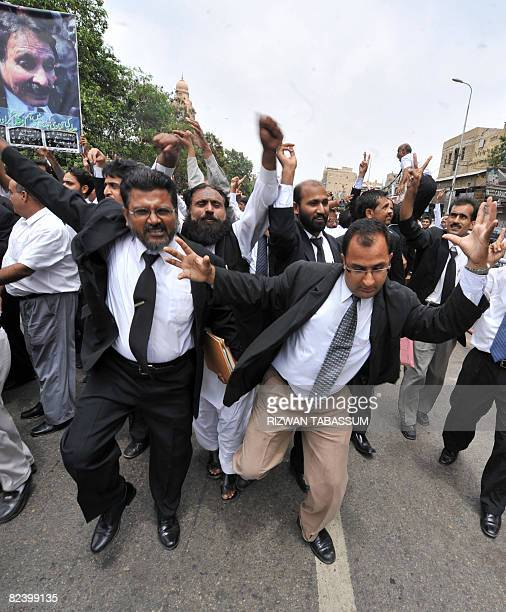 Pakistani lawyers celebrate the resignation of President Pervez Musharraf during a march on a street in Karachi on August 18 2008 Musharraf announced...