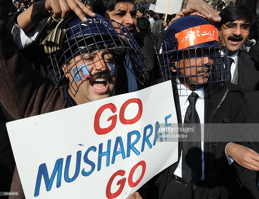 Pakistani lawyers wear riot police helmets after a clash as they shout slogans during a protest rally near the residence of sacked Supreme Court Chief Justice Iftikhar Mohammad Chaudhry during a protest rally in Islamabad, 24 January 2008. Pakistani riot police used tear gas and batons to disperse hundreds of protesters chanting slogans against President Pervez Musharraf. AFP PHOTO/Aamir QURESHI