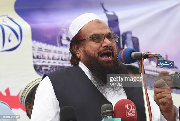 Pakistani leader of the Jamaat ud Dawa organisation Hafiz Muhammad Saeed speaks during a rally to support the government of Saudi Arabia over the...