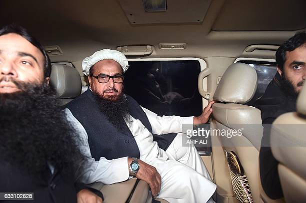 Pakistani leader of the JamaatudDawa organisation Hafiz Saeed leaves in a car after being detained by police in Lahore early on January 31 2017...
