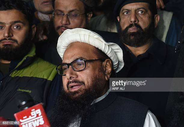 Pakistani leader of the JamaatudDawa organisation Hafiz Saeed speaks to the press after being detained by police in Lahore early on January 31 2017...