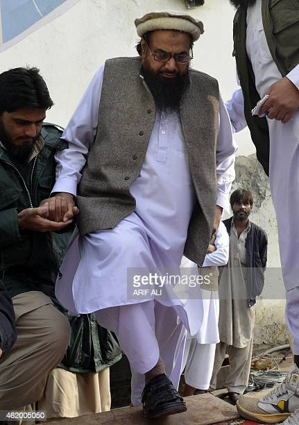 Pakistani leader of the Jamat udDawa organisation Hafiz Saeed arrives to address a rally held to protest the printing of satirical sketches of the...