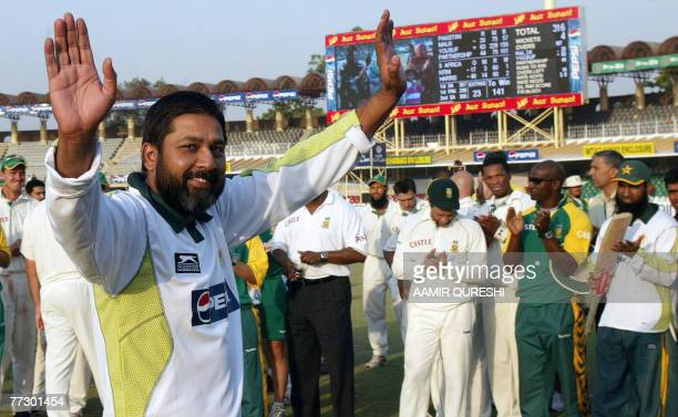 Pakistani legend cricketer Inzamam-ul-Haq waves to the crowd during a ceremony at the Gaddafi Cricket Stadium in Lahore, 12 October 2007. Pakistan's...