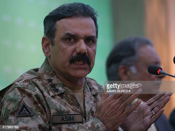 Pakistani Lieutenant General Asim Bajwa speaks with media representatives as he gives details of arrested man Kulbhushan Yadav who is suspected of...