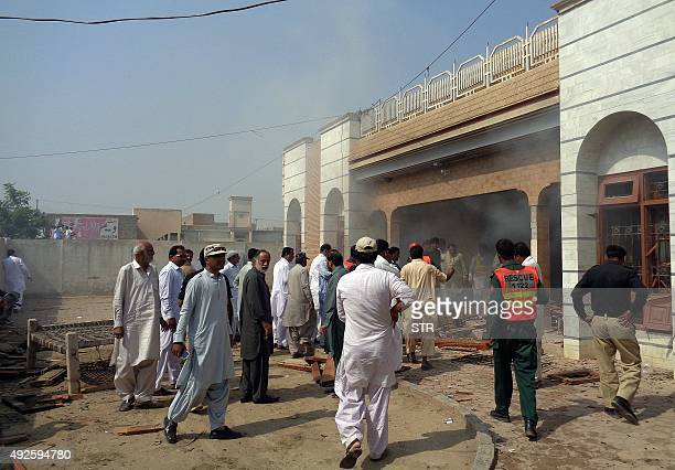 Pakistani local residents gather at the site of a suspected suicide bomb attack in Taunsa town near Dera Ghazi Khan city in the southern part of...