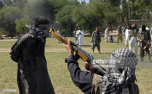 A Pakistani local Taliban using a an AK47 Kalashnikov automatic rifle shoots a kidnapper in Rahim Kor village near the Mammad agency some 60...