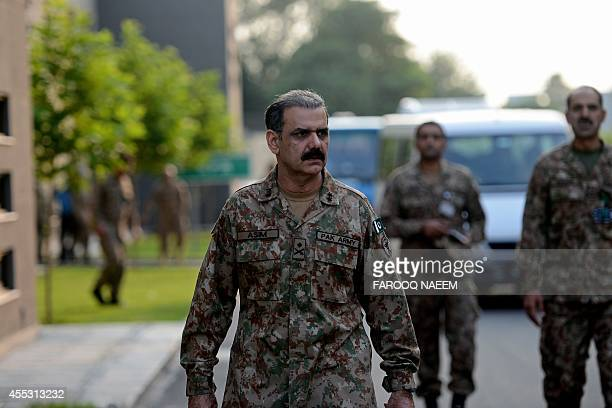 Pakistani Major General Asim Bajwa arrives to speak with media representatives where he announced the capture of the militants who in October 2012...